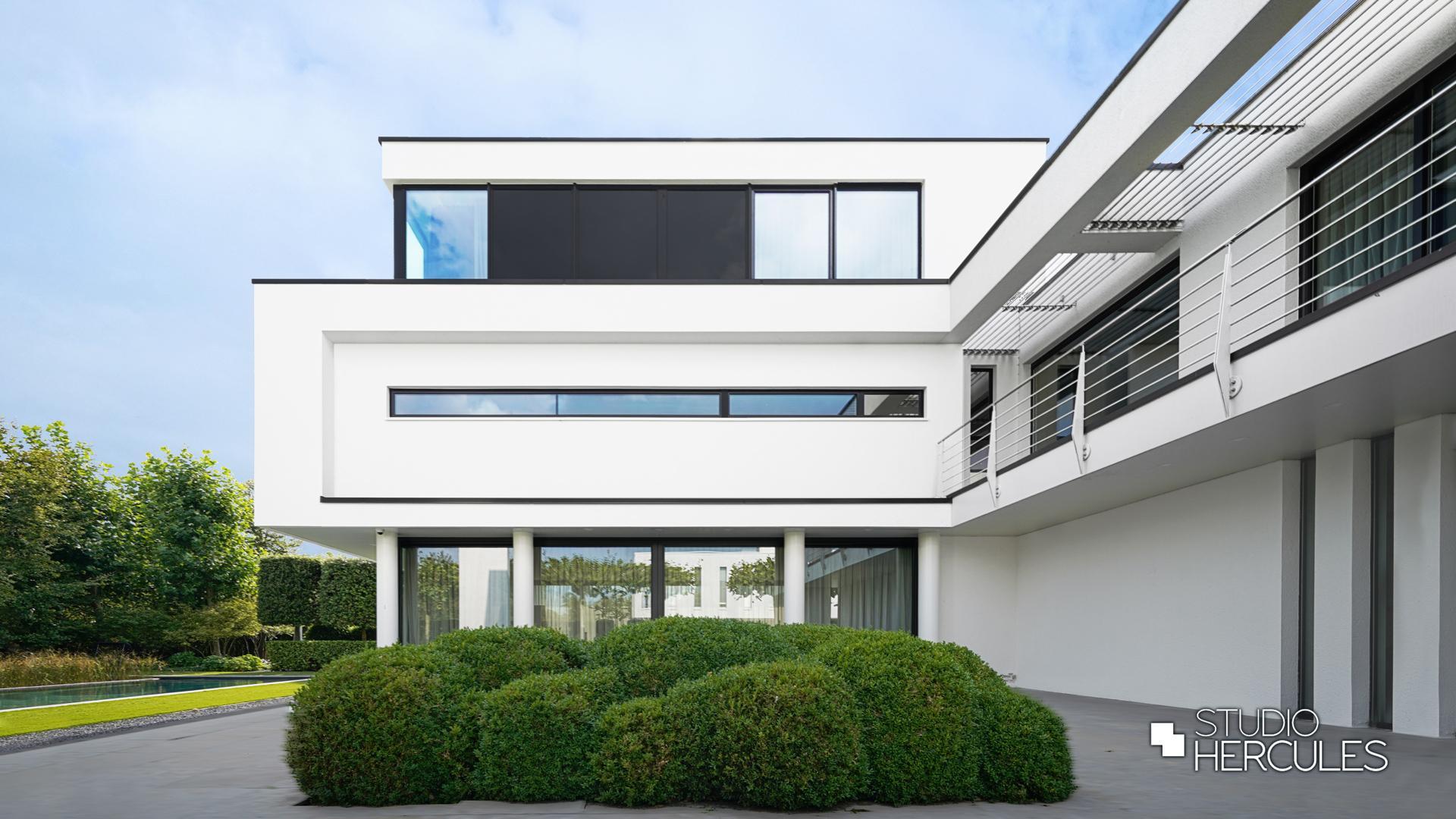 StudioHercules Ibiza stijl zijgevel in modern stucwerk.